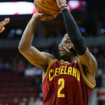 Cleveland Cavaliers guard Kyrie Irving shoots an outside shot during the first quarter of an NBA basketball game against the Portland Trail Blazers in Portland, Ore., Wednesday, Jan. 16, 201 …