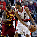Portland Trail Blazers forward Nicolas Batum, right, from France, looks to pass against the defense of Cleveland Cavaliers guard Kyrie Irving during the first quarter of an NBA basketball ga …