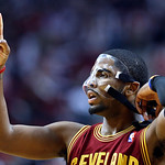 Cleveland Cavaliers guard Kyrie Irving calls a play as he adjusts his mask during the second half of an NBA basketball game against the Portland Trail Blazers in Portland, Ore., Wednesday, J …