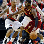 Cleveland Cavaliers guard Kyrie Irving, right, dribbles against Portland Trail Blazers guard Damian Lillard during the second half of an NBA basketball game in Portland, Ore., Wednesday, Jan …
