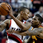 Cleveland Cavaliers forward Alonzo Gee, right, pressures Portland Trail Blazers guard Damian Lillard during the first quarter of an NBA basketball game in Portland, Ore., Wednesday, Jan. 16, …
