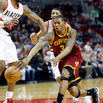 Cleveland Cavaliers forward Alonzo Gee, right, passes inside against Portland Trail Blazers forward LaMarcus Aldridge during the first quarter of an NBA basketball game in Portland, Ore., We …