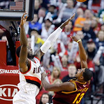 Cleveland Cavaliers forward Tristan Thompson, right, shoots over Portland Trail Blazers center J.J. Hickson during the second half of an NBA basketball game in Portland, Ore., Wednesday, Jan …