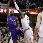 Sacramento Kings' Aaron Brooks (3) shoots over Cleveland Cavaliers' Kyrie Irving (2) late in the fourth quarter of an NBA basketball game on Wednesday, Jan. 2, 2013, in Cleveland. The Kings  …