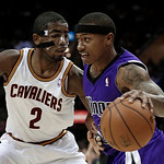 Sacramento Kings' Isaiah Thomas, right, drives past Cleveland Cavaliers' Kyrie Irving during the first quarter of an NBA basketball game on Wednesday, Jan. 2, 2013, in Cleveland. (AP Photo/T …
