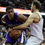 Sacramento Kings' Jason Thompson, left, is fouled by Cleveland Cavaliers' Luke Walton during the second quarter of an NBA basketball game on Wednesday, Jan. 2, 2013, in Cleveland. (AP Photo/ …