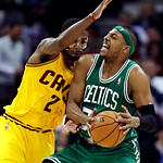 Boston Celtics' Paul Pierce, right, is stopped by Cleveland Cavaliers' Kyrie Irving during the second quarter of an NBA basketball game, Tuesday, Jan. 22, 2013, in Cleveland. (AP Photo/Tony  …