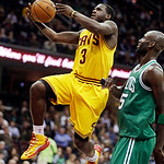 Cleveland Cavaliers' Dion Waiters (3) jumps to the basket against Boston Celtics' Kevin Garnett (5) during the second quarter of an NBA basketball game, Tuesday, Jan. 22, 2013, in Cleveland. …