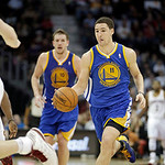 Golden State Warriors' Klay Thompson (11) brings the ball up against the Cleveland Cavaliers in an NBA basketball game Tuesday, Jan. 29, 2013, in Cleveland. (AP Photo/Mark Duncan)