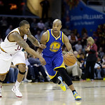 Golden State Warriors' Jarrett Jack (2) drives on Cleveland Cavaliers' Alonzo Gee in an NBA basketball game Tuesday, Jan. 29, 2013, in Cleveland. (AP Photo/Mark Duncan)