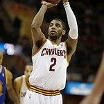 Cleveland Cavaliers' Kyrie Irving shoots against the Golden State Warriors in an NBA basketball game Tuesday, Jan. 29, 2013, in Cleveland. (AP Photo/Mark Duncan)