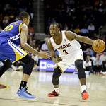 Cleveland Cavaliers' Dion Waiters (3) drives on Golden State Warriors' Kent Bazemore in an NBA basketball game Tuesday, Jan. 29, 2013, in Cleveland. (AP Photo/Mark Duncan)