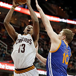 Cleveland Cavaliers' Tristan Thompson (13) takes a shot over Golden State Warriors' David Lee (10) in the fourth quarter of an NBA basketball game Tuesday, Jan. 29, 2013, in Cleveland. Golde …
