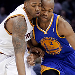 Golden State Warriors' Jarrett Jack (2) collides with Cleveland Cavaliers' Alonzo Gee on a drive in the first quarter of an NBA basketball game Tuesday, Jan. 29, 2013, in Cleveland. (AP Phot …