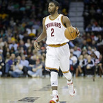 Cleveland Cavaliers' Kyrie Irving walks the ball up against the Golden State Warriors in an NBA basketball game Tuesday, Jan. 29, 2013, in Cleveland. (AP Photo/Mark Duncan)