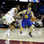 Golden State Warriors' Klay Thompson (11) drives on Cleveland Cavaliers' Alonzo Gee in an NBA basketball game Tuesday, Jan. 29, 2013, in Cleveland. (AP Photo/Mark Duncan)