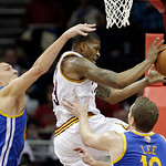 Golden State Warriors' Andris Biedrins, left, fouls Cleveland Cavaliers' Alonzo Gee during the first quarter of an NBA basketball game Tuesday, Jan. 29, 2013, in Cleveland. (AP Photo/Mark Du …