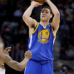 Golden State Warriors' Klay Thompson shoots against the Cleveland Cavaliers in the third quarter of an NBA basketball game Tuesday, Jan. 29, 2013, in Cleveland. Thompson scored 32 points, in …
