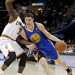 Golden State Warriors' Klay Thompson (11) drives on Cleveland Cavaliers' Dion Waiters during the first quarter of an NBA basketball game Tuesday, Jan. 29, 2013, in Cleveland. (AP Photo/Mark …