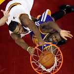 Cleveland Cavaliers' Tristan Thompson, left, dunks on Golden State Warriors' Festus Ezeli during the second quarter of an NBA basketball game Tuesday, Jan. 29, 2013, in Cleveland. (AP Photo/ …