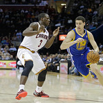 Golden State Warriors' Klay Thompson (11) drives on Cleveland Cavaliers' Dion Waiters (3) ion an NBA basketball game Tuesday, Jan. 29, 2013, in Cleveland. (AP Photo/Mark Duncan)