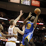 Golden State Warriors' Draymond Green (23) shoots over Cleveland Cavaliers' Tyler Zeller in an NBA basketball game Tuesday, Jan. 29, 2013, in Cleveland. (AP Photo/Mark Duncan)