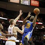 Golden State Warriors' Draymond Green (23) shoots over Cleveland Cavaliers' Tyler Zeller in an NBA basketball game Tuesday, Jan. 29, 2013, in Cleveland. (AP Photo/Mark Duncan)