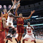 Chicago Bulls guard Nate Robinson, center left, passes past the Cleveland Cavaliers defense of Shaun Livingston (14), Tyler Zeller (40) and Kevin Jones (5) as Bulls' Nazr Mohammed (48) watch …
