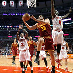 Cleveland Cavaliers forward Omri Casspi (36) scores between Chicago Bulls' Nate Robinson (2) and Luol Deng (9) during the second half of an NBA basketball game Monday, Jan. 7, 2013, in Chica …