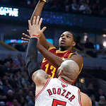 Cleveland Cavaliers forward Tristan Thompson (13) shoots over Chicago Bulls forward Carlos Boozer (5) during the first half of an NBA basketball game Monday, Jan. 7, 2013, in Chicago. (AP Ph …