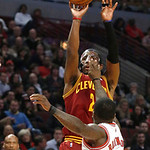 Cleveland Cavaliers guard Kyrie Irving (2) shoots over Chicago Bulls guard Nate Robinson during the first half of an NBA basketball game Monday, Jan. 7, 2013, in Chicago. (AP Photo/Charles R …