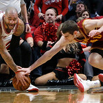 Chicago Bulls forward Carlos Boozer, left, grabs a loose ball from Cleveland Cavaliers center Tyler Zeller (40) and Kyrie Irving during the second half of an NBA basketball game Monday, Jan. …