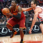 Cleveland Cavaliers guard Dion Waiters, left, is grabbed from behind by Chicago Bulls center Joakim Noah during the first half of an NBA basketball game Monday, Jan. 7, 2013, in Chicago. (AP …