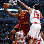 Cleveland Cavaliers forward Alonzo Gee (33) drives and scores past Chicago Bulls center Joakim Noah during the first half of an NBA basketball game Monday, Jan. 7, 2013, in Chicago. (AP Phot …