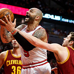 Chicago Bulls forward Carlos Boozer (5) is fouled by Cleveland Cavaliers forward Jon Leuer (30) during the second half of an NBA basketball game Monday, Jan. 7, 2013, in Chicago. The Bulls w …
