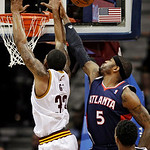 Atlanta Hawks' Josh Smith (5) blocks a shot by Cleveland Cavaliers' Alonzo Gee (33) in the third quarter of an NBA basketball game, Wednesday, Jan. 9, 2013, in Cleveland. Smith led the Hawks …