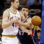 Cleveland Cavaliers' Tyler Zeller (40) and Atlanta Hawks' Zaza Pachulia, of Georgia, fight for a loose ball in the first quarter of an NBA basketball game, Wednesday, Jan. 9, 2013, in Clevel …