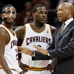 Cleveland Cavaliers head coach Byron Scott, right, talks with Kyrie Irving, left, and Dion Waiters in the fourth quarter of an NBA basketball game against the Atlanta Hawks, Wednesday, Jan.  …