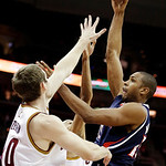 Atlanta Hawks' Al Horford, right, shoots over Cleveland Cavaliers' Tyler Zeller in the second quarter of an NBA basketball game, Wednesday, Jan. 9, 2013, in Cleveland. (AP Photo/Mark Duncan)