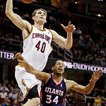 Cleveland Cavaliers' Tyler Zeller (40) is fouled by Atlanta Hawks' Devin Harris (34) in the fourth quarter of an NBA basketball game, Wednesday, Jan. 9, 2013, in Cleveland. The Cavaliers won …
