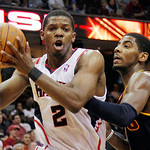 Atlanta Hawks' Joe Johnson (2) drives to the basket against Cleveland Cavaliers' Kyrie Irving, right, in the second half of an NBA basketball game in Cleveland on Sunday, March 18, 2012. The …