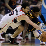 Atlanta Hawks' Kirk Hinrich (6) and Cleveland Cavaliers' Kyrie Irving (2) fight for a loose ball in the second quarter of an NBA basketball game in Cleveland on Sunday, March 18, 2012.  (AP  …