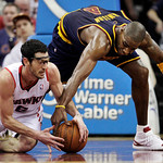 Atlanta Hawks' Kirk Hinrich, left, fights for a loose ball with Cleveland Cavaliers' Antawn Jamison in the first quarter of an NBA basketball game in Cleveland on Sunday, March 18, 2012. (AP …