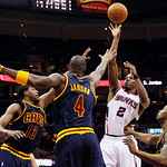 Atlanta Hawks' Joe Johnson (2) shoots while defended by Cleveland Cavaliers' Tristan Thompson (13), Antawn Jamison (4) and Alonzo Gee, right, in the second half of an NBA basketball game in  …