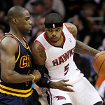 Atlanta Hawks' Josh Smith (5) pushes to the lane against Cleveland Cavaliers' Antawn Jamison, left, in the first half of an NBA basketball game in Cleveland on Sunday, March 18, 2012. (AP Ph …