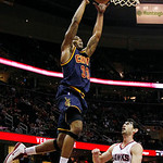 Cleveland Cavaliers' Alonzo Gee (33) goes for a dunk against Atlanta Hawks' Kirk Hinrich in the first quarter of an NBA basketball game in Cleveland on Sunday, March 18, 2012. (AP Photo/Amy  …