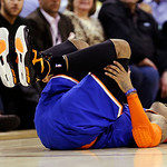 New York Knicks&#039; Carmelo Anthony lays on the court after falling in the second quarter of an NBA basketball game against the Cleveland Cavaliers, Monday, March 4, 2013, in Cleveland. Anthony &#8230;