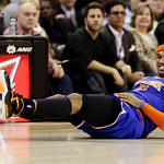 New York Knicks' Carmelo Anthony grimaces after falling in the second quarter of an NBA basketball game against the Cleveland Cavaliers, Monday, March 4, 2013, in Cleveland. (AP Photo/Tony D …