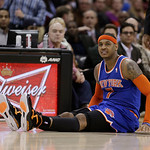 New York Knicks' Carmelo Anthony sits up after falling during the second quarter of an NBA basketball game against the Cleveland Cavaliers Monday, March 4, 2013, in Cleveland. (AP Photo/Tony …