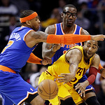 Cleveland Cavaliers' Wayne Ellington, right, passes the ball under pressure from New York Knicks' Carmelo Anthony, left, and Amare Stoudemire during the first quarter of an NBA basketball ga …